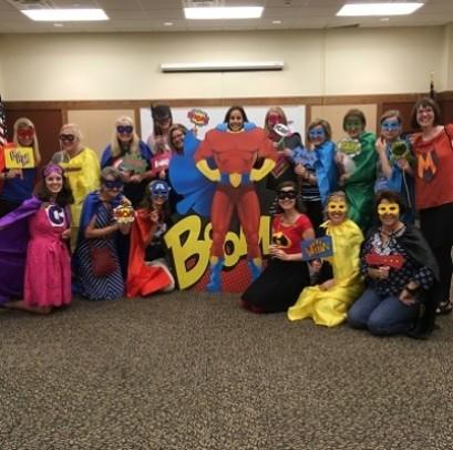 Klondike teachers dress as Superheroes at Family Reading Night.